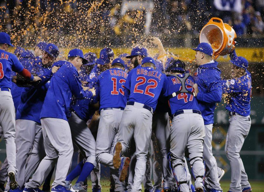 The Chicago Cubs douse each other after defeating the Pittsburgh Pirates in the National League wild card baseball game, 4-0, Wednesday, Oct. 7, 2015, in Pittsburgh. They advance to play the St. Louis Cardinals in the National League division series. (AP Photo/Gene J. Puskar)