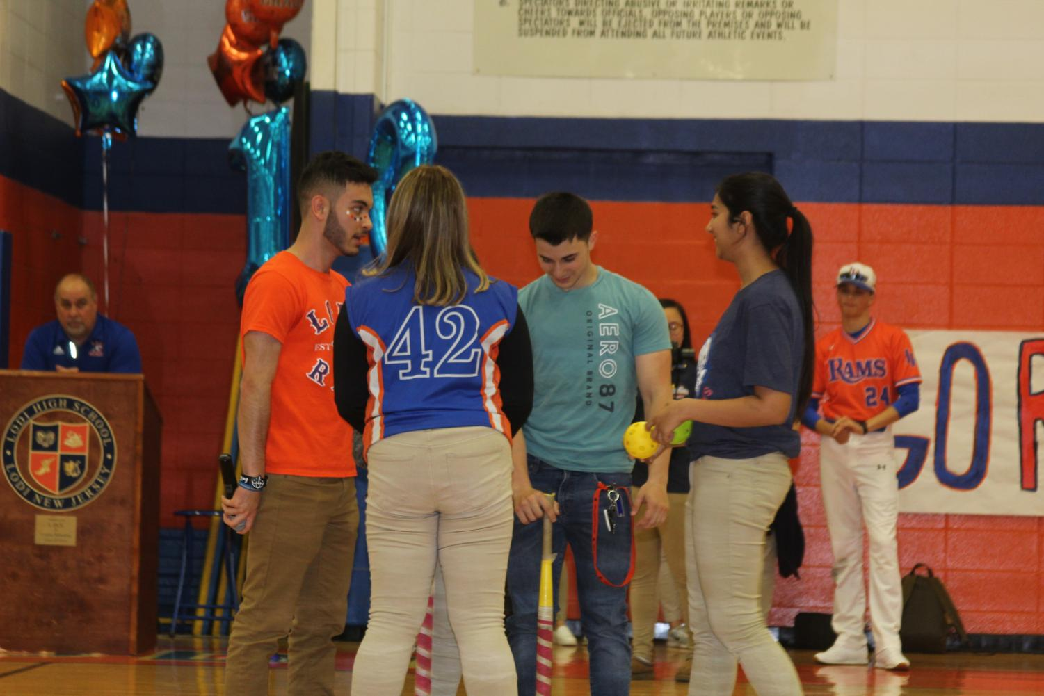 Vice+President+Hardeep+Kaur+and+President+Andres+Balvin+explaining+the+game+to+the+participants+