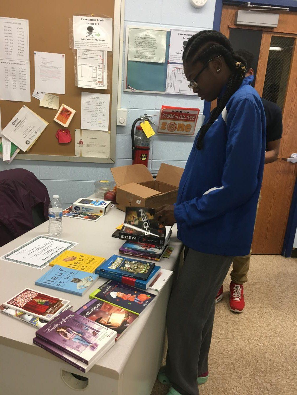 Nilya+browsing+the+numerous+donated+books